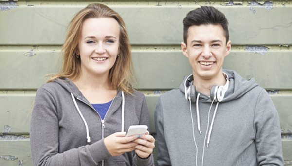 43051815 - teenager couple sharing text message on mobile phone